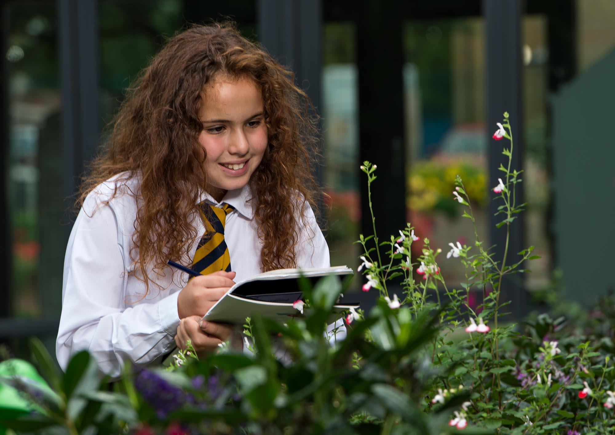 Girl drawing flowers outside