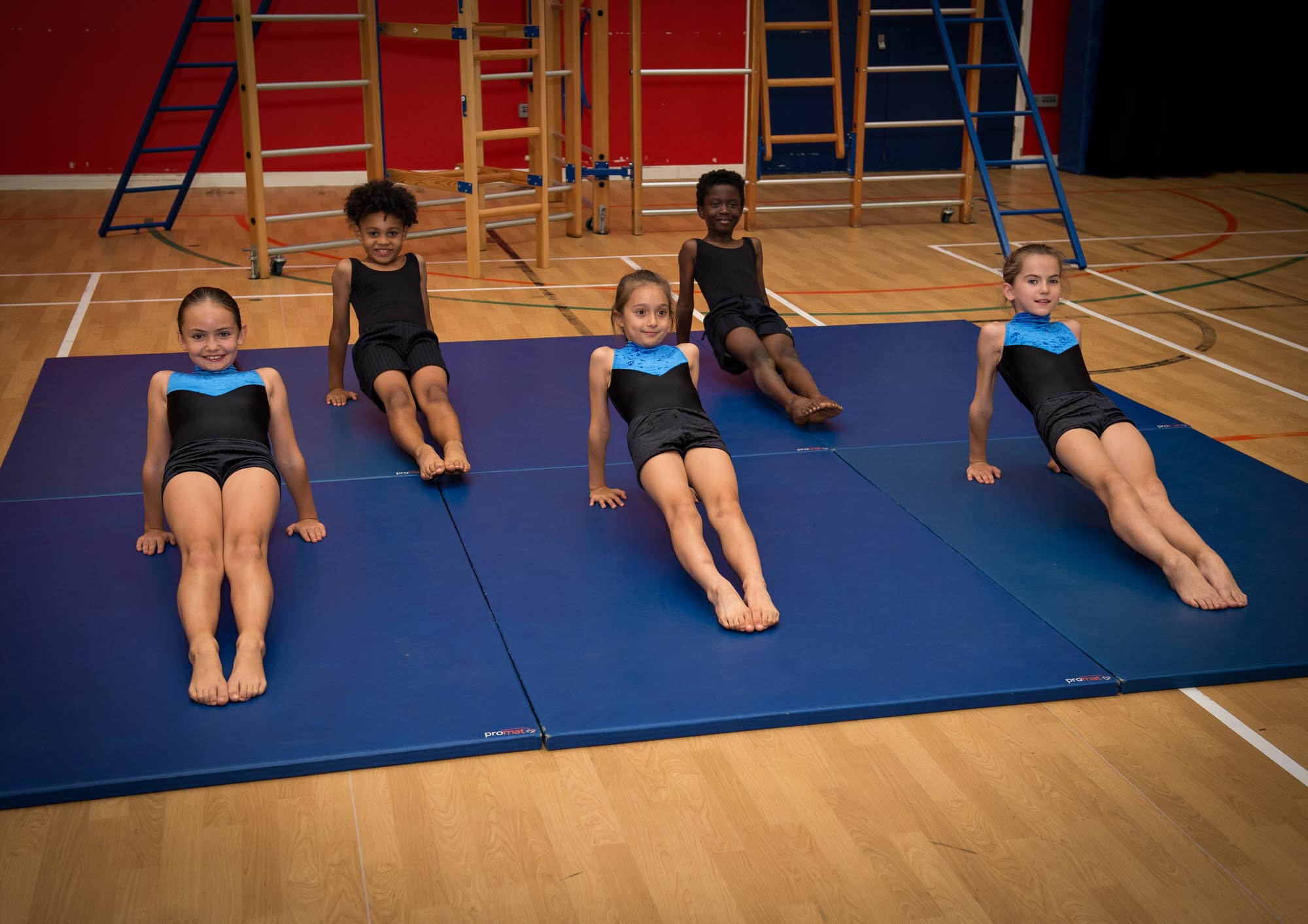 Gymnastic strength exercises on floor