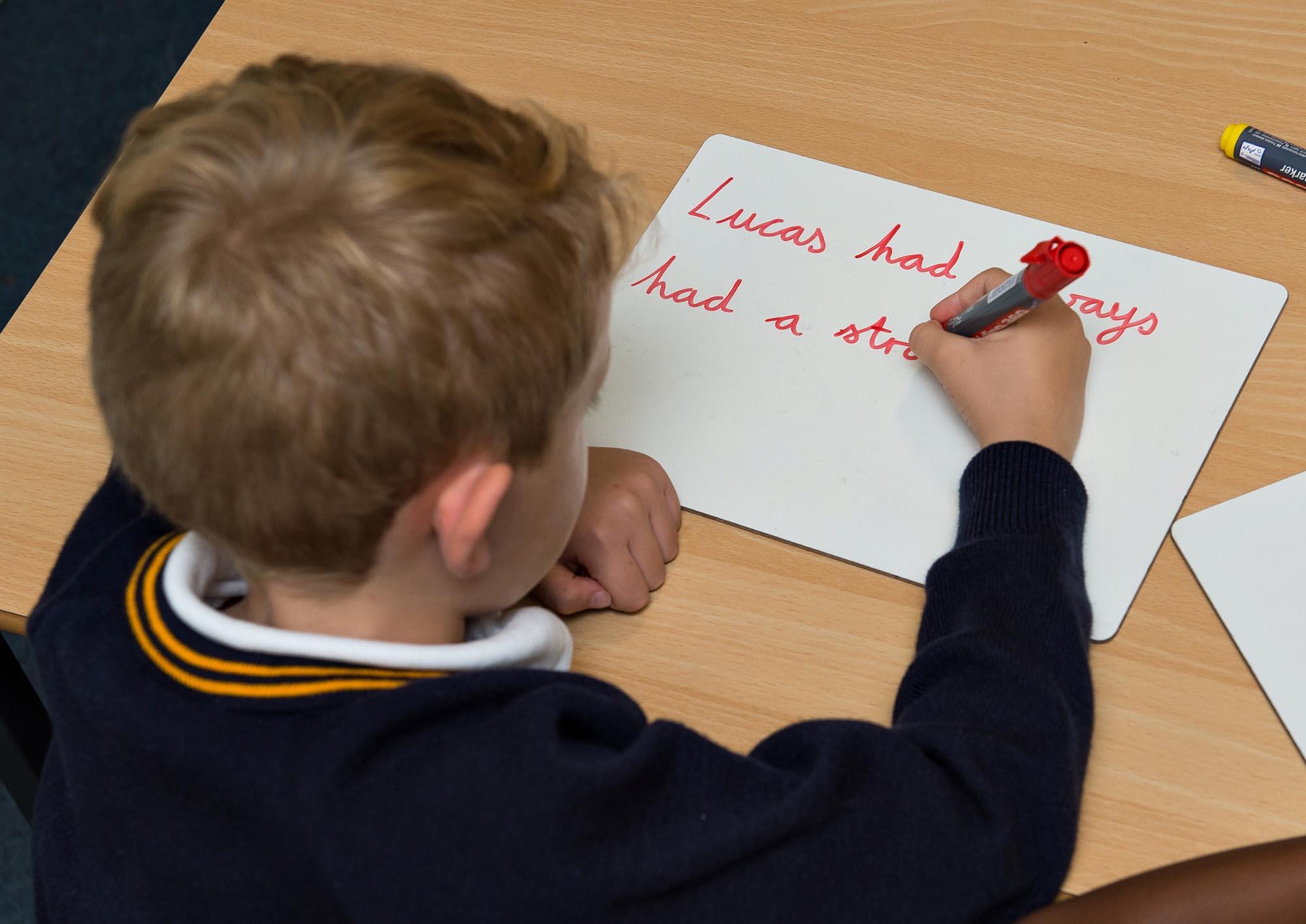 Boy writing on card