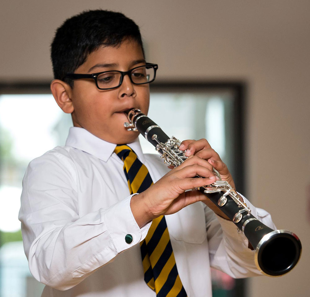 Boy playing the clarinet
