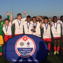 Boys with medals and trophy