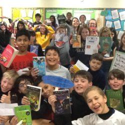 Children holding up books