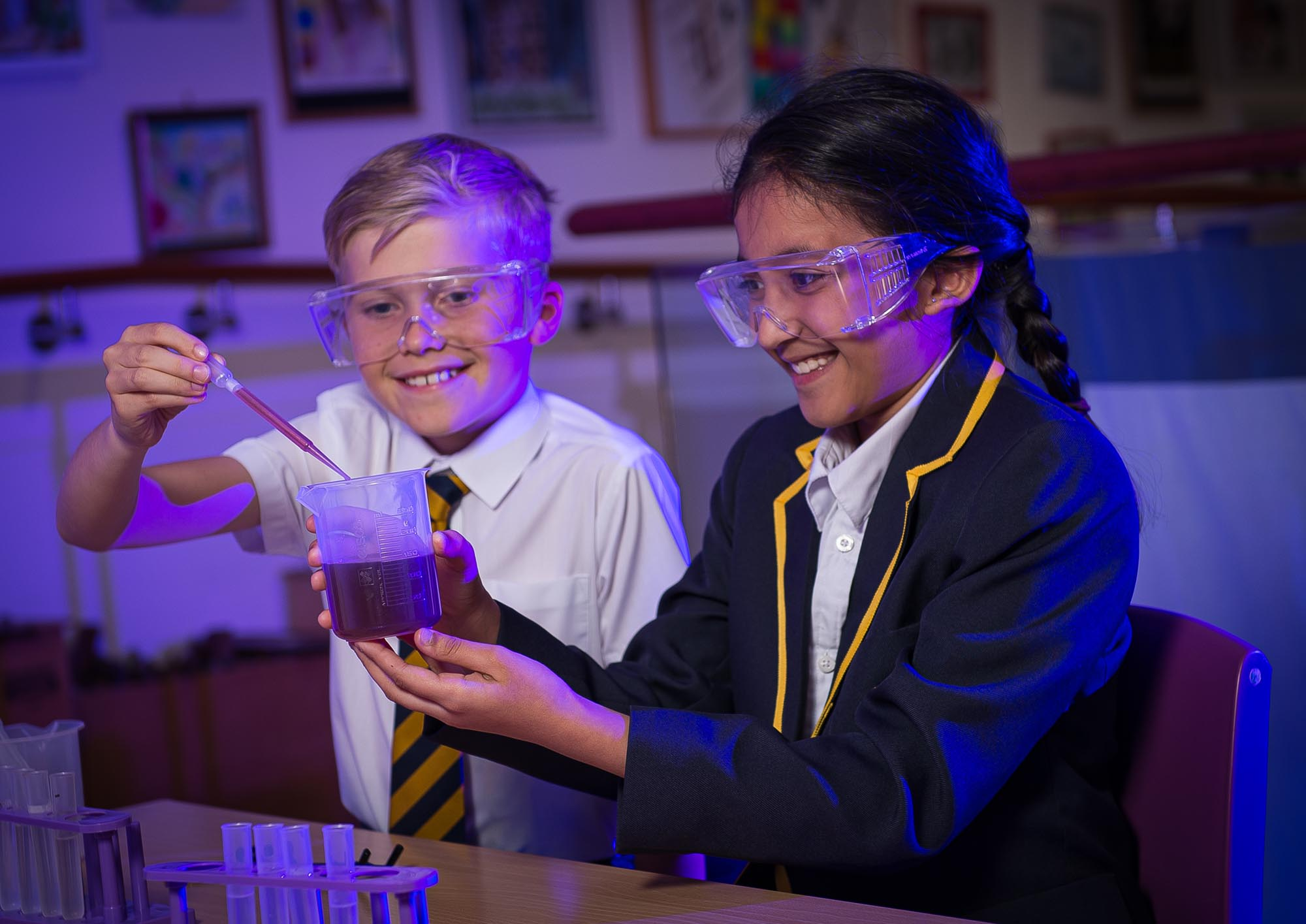 Boy and girl doing science experiment