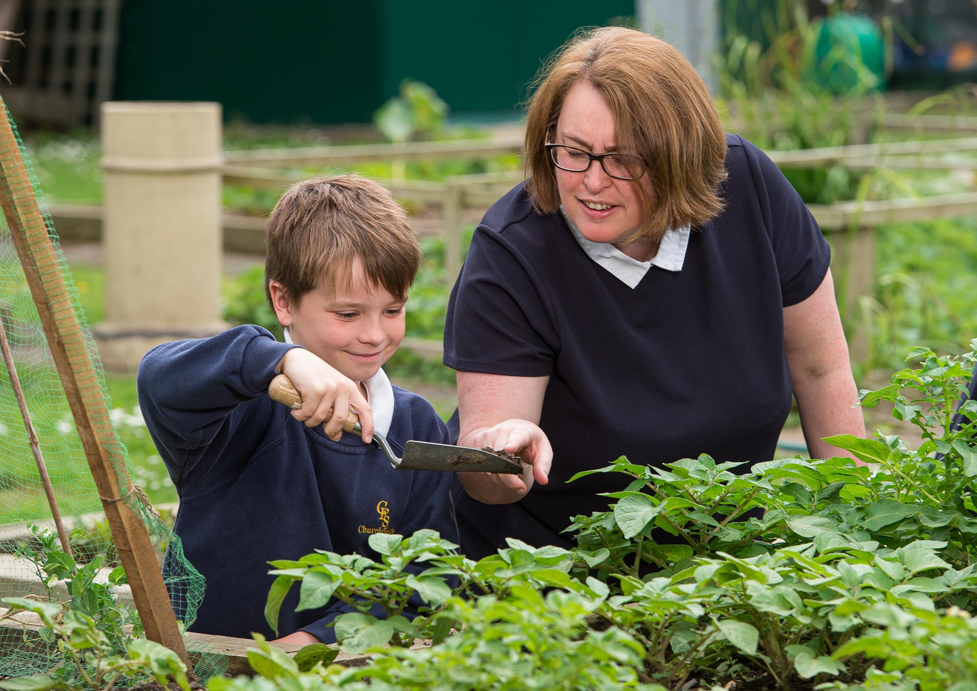 Head Teacher and pupil doing gardening