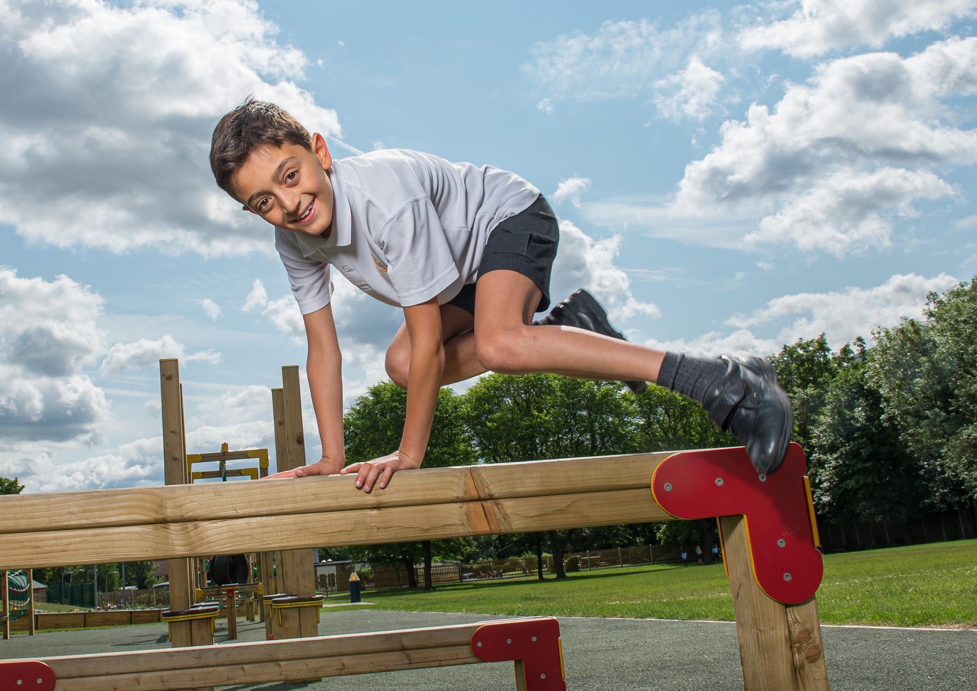 Boy hurdling