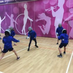 Children trying out fencing