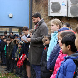 Pupils and staff showing their respect at Remembrance Day
