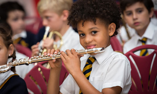 Pupil playing the flute in the orchestra