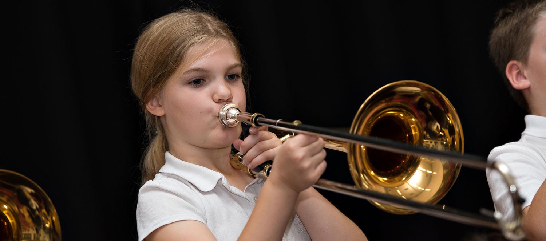 Girl playing trombone