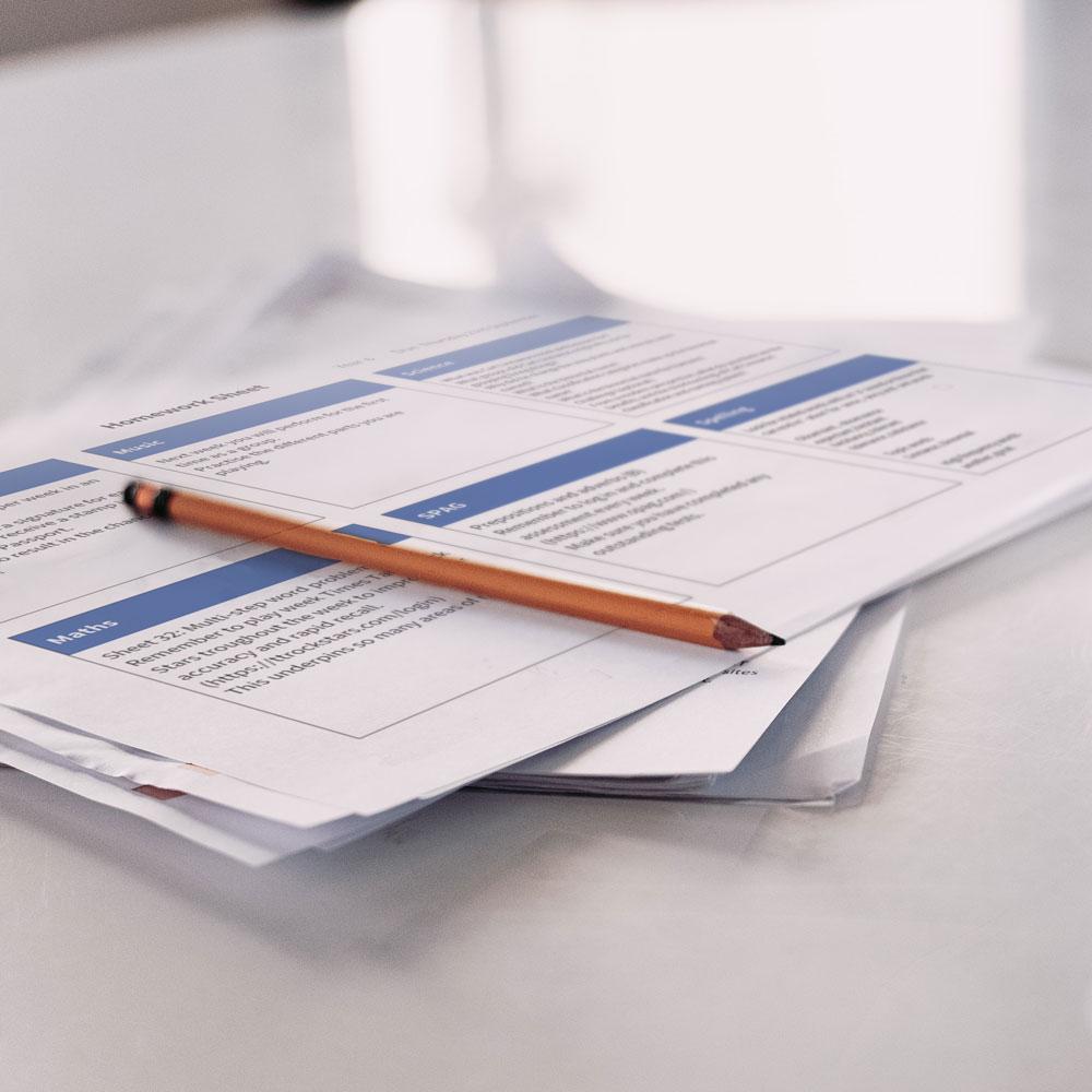 Homework sheet on table
