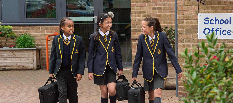 Pupils in uniform leaving the school