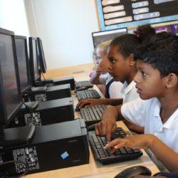 Children in front of computers