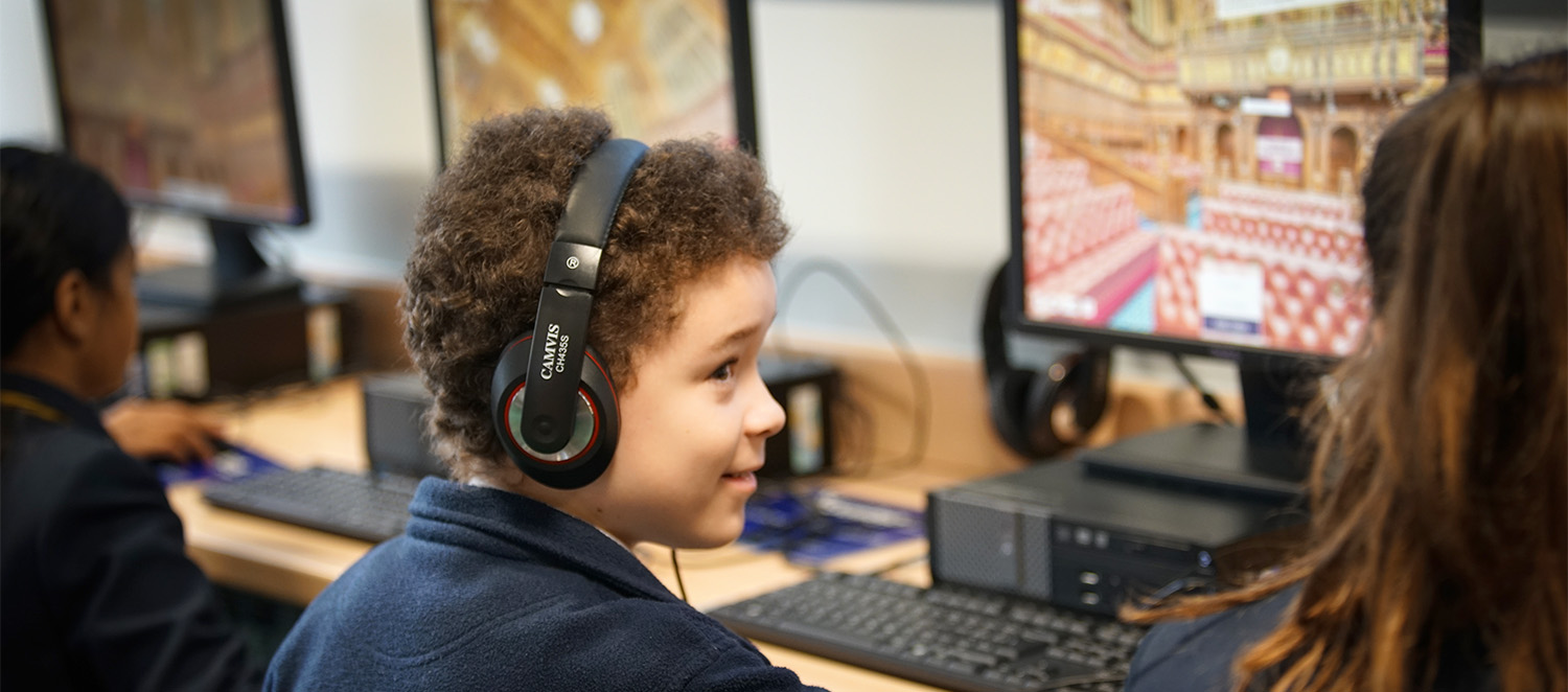 Parliament online visit - boy with headphones in front of computer