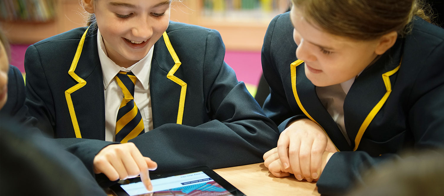 Parliament online visit - girl pointing at tablet