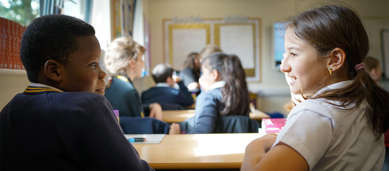 Pair of pupils discussing