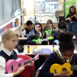 Children learning how to play the ukulele